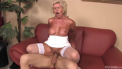 Mature granny Effie gives a titjob and rides her younger lover