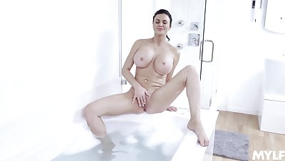 Big boobs MILF massages her womanhood in a warm carbuncle bath